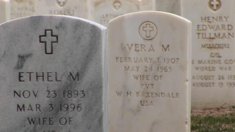 A close-up tracking shot of the inscriptions for both men and women buried in Arlington National Cem Footage