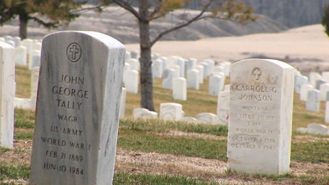 A look at white marble headstones at Arlington National Cemetery Footage