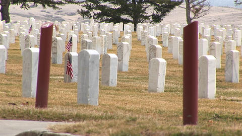 A detail of Arlington National Cemetery with white headstones and section markers Footage