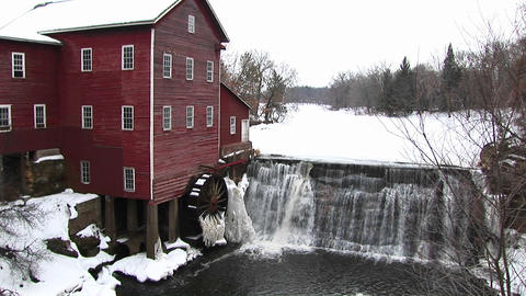 Ice immobilizes an old gristmill's waterwheel Stock Video Footage