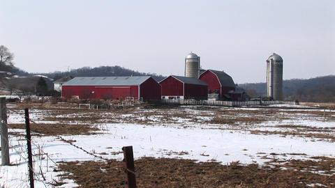 Long shot of farm buildings in winter Stock Video Footage