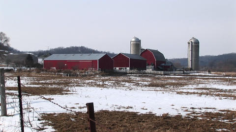 Long shot of farm buildings in winter Stock Video Footage