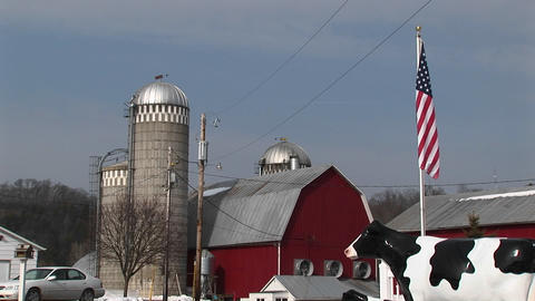 The camera captures an American farm with silos, red... Stock Video Footage