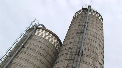 Worms-eye view of two silos Footage