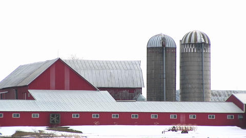 A fan turns on a red barn Stock Video Footage