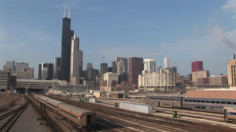 A commuter train passes through this long shot of Chicago's skyline and skyscrapers Footage