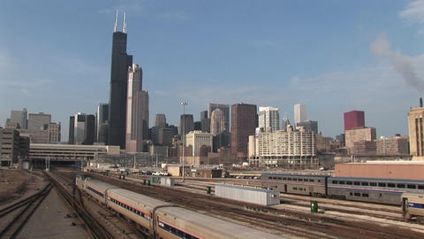 A commuter train passes through this long shot of... Stock Video Footage