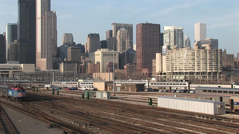 A passenger train heads out of Chicago Stock Video Footage