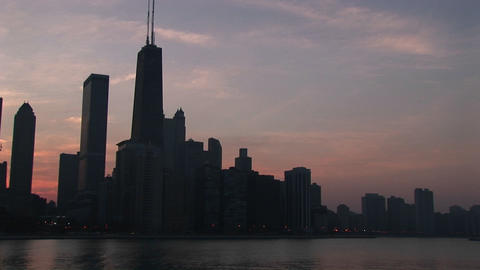 Medium shot of the Chicago skyline at golden hour from Lake Michigan Footage