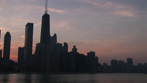 Medium shot of the Chicago skyline at golden hour from... Stock Video Footage