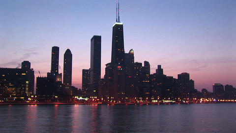 Chicago's Sears Tower dominates this skyline shot during golden-hour Footage