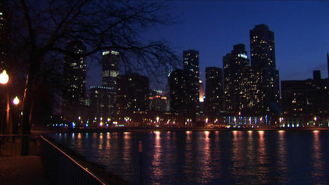 The Chicago skyline after dark with lights reflected in Lake Michigan Footage