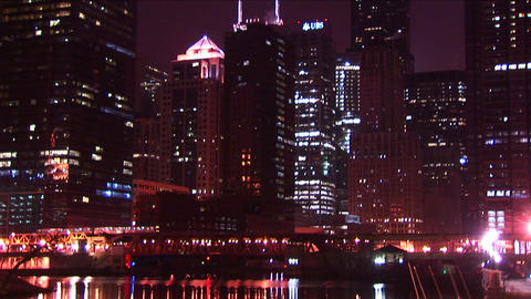 Chicago's buildings sparkle at night as a commuter train... Stock Video Footage