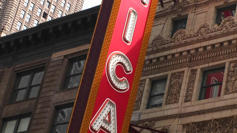 The camera pans down the Chicago Theater's colorful marquee Footage