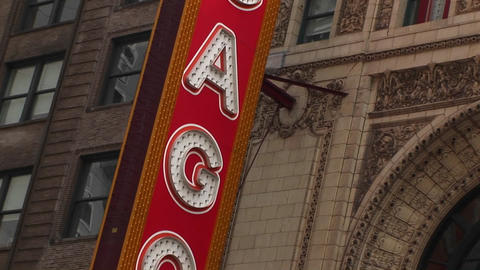 The camera pans down the Chicago Theater's colorful marquee Stock Video Footage