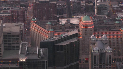 An aerial view of Chicago's landmark Merchandise Mart includes its green roof-towers and exterior li Footage
