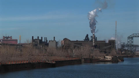 Power plants and other industrial buildings are located near a river Footage
