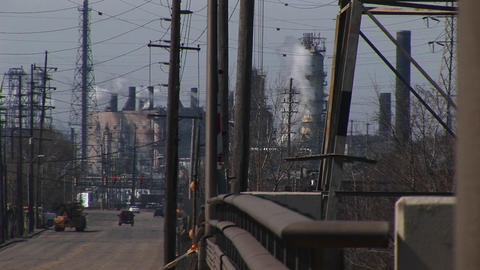 An inner-city industrial area with refineries, utility... Stock Video Footage