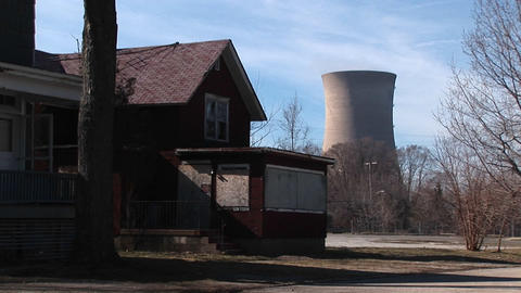 A boarded up home located near a nuclear power plant Stock Video Footage