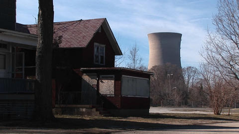A boarded up home located near a nuclear power plant Footage