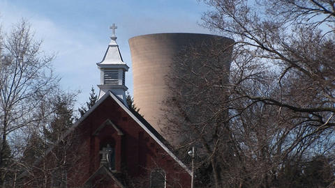 A church is located close to a nuclear power plant Stock Video Footage