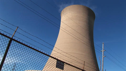 A nuclear power plant is protected by a high cyclone fence and barbed-wire Footage