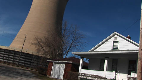A look from street-level and a residential home to the top of a nearby nuclear power plant Footage