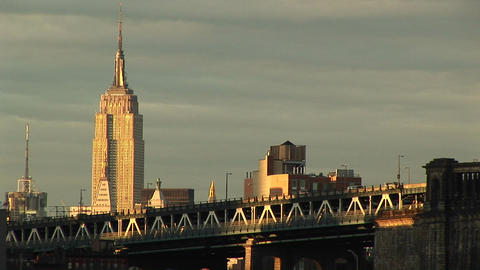 The Empire State Building rises above the surrounding buildings and freeway in the foreground Footage