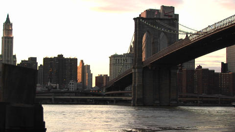 A look at the Brooklyn Bridge connecting Brooklyn with Manhattan includes nice footage of a ferry bo Footage