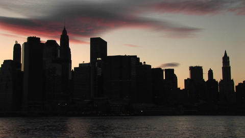 The camera pans from the Brooklyn Bridge to the... Stock Video Footage