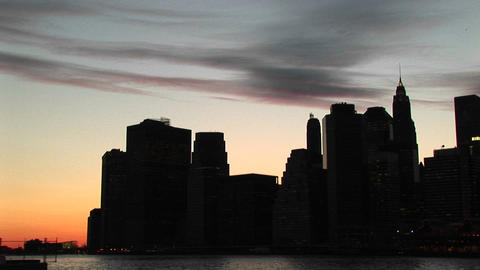 A silhouetted look at New York's skyscrapers at the golden-hour Footage