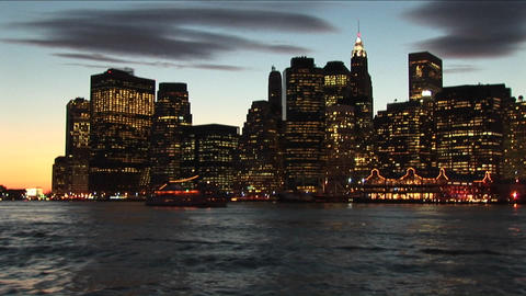 New York skyline, illuminated with lights and the golden... Stock Video Footage