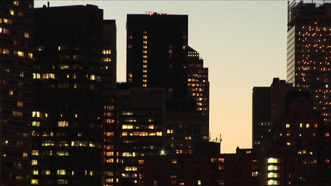 New York skyline, illuminated with lights and the golden hour, are presented with a variety of speci Footage