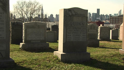 The camera pans back and forth in this cemetery with the... Stock Video Footage