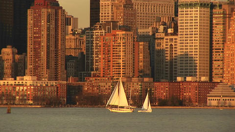 sailboats pass each other on a bright sailing day with Manhattan in the background Footage