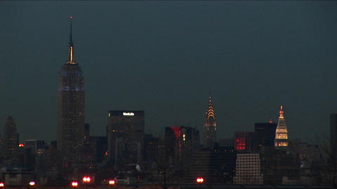 An after-dark shot of New York's landmark buildings Stock Video Footage