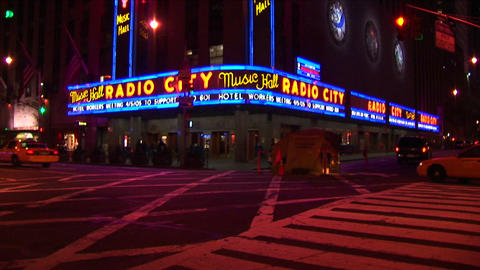 The camera pans down the Radio City Music Hall signs and... Stock Video Footage