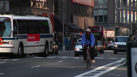 A brave bicyclist and pedestrian deal with heavy traffic... Stock Video Footage