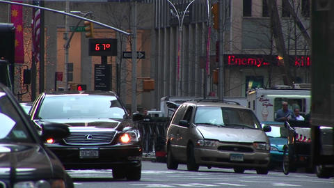 A crowded New York street scene includes heavy traffic,... Stock Video Footage