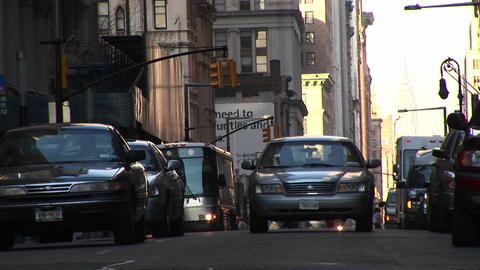 An eye-level look at traffic and pedestrians at an urban... Stock Video Footage