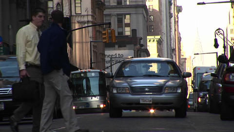An eye-level look at traffic and pedestrians at an urban intersection Footage