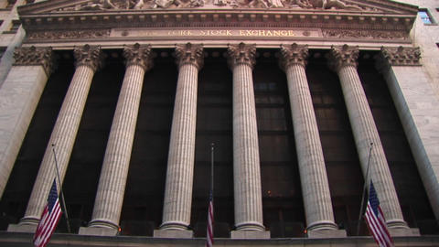 A worms-eye view of the exterior of the Stock Exchange Building focuses on its Corinthian columns an Footage