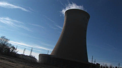Steam rises from the top of a nuclear power plant in this... Stock Video Footage