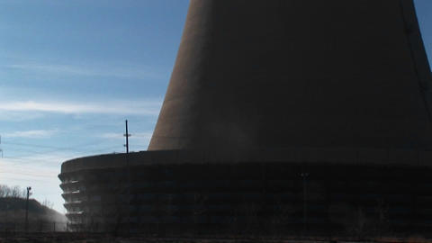 The camera pans from the base to the top of a nuclear... Stock Video Footage