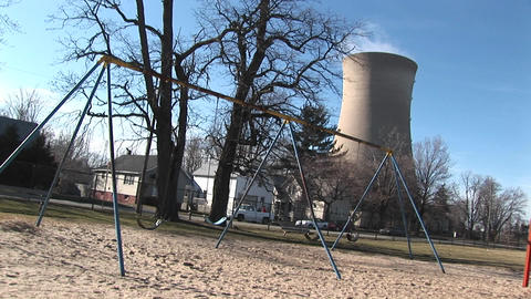 An otherwise typical residential neighborhood has been joined by a nuclear power plant Footage