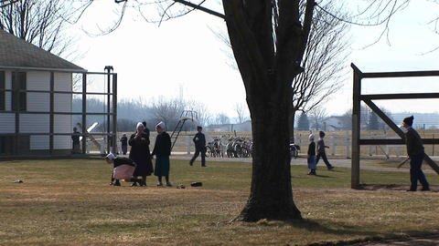 A group of Amish young people are playing games outdoors Stock Video Footage