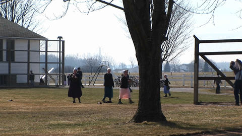 A group of Amish young people are playing games outdoors Footage