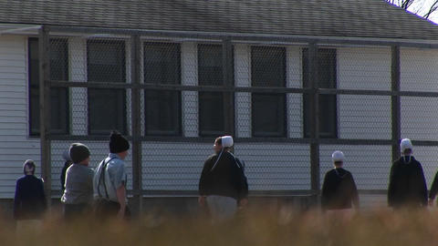 A group of Amish children play together before school and... Stock Video Footage