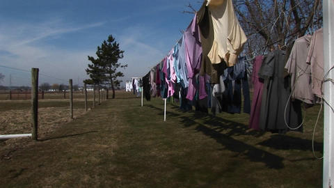 Colorful laundry hangs outdoors to dry in a rural community Footage