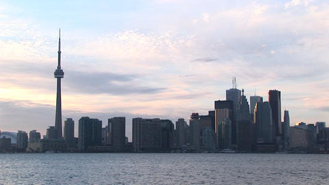 Toronto's CN tower dwarfs the remaining skyscrapers in this Toronto skyline picture Footage